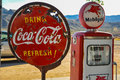 Retro gas pump and rusty coca cola sign on route in arizona Royalty Free Stock Photos