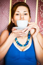 Retro girl in blue dress with tea cup Royalty Free Stock Image