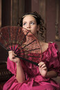 Retro the girl with a fan Royalty Free Stock Image