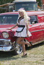 Retro girl with old car Royalty Free Stock Photo