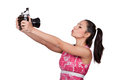 Retro girl in a pink dress holding his hands an old camera photographer himself makes grimace on white background Royalty Free Stock Image