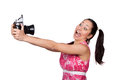 Retro girl in a pink dress holding his hands an old camera photographer himself makes grimace on white background Stock Photo