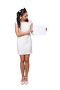 Retro girl in a white dress woman holding blank paper on background Stock Photography