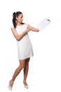 Retro girl in a white dress woman holding blank paper pointing at it with his finger isolated on background Royalty Free Stock Photo