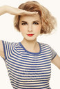 Retro girl young beautiful in striped sailor top looking upwards over white background Royalty Free Stock Photo
