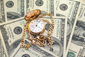 Retro golden pocket watch on Hundred Dollars. Royalty Free Stock Photo