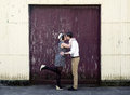 Retro hip hipster romantic love couple kissing industrial setting young vintage Royalty Free Stock Photo