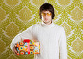 Retro hip young man glasses holding  gift box Royalty Free Stock Photo