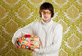 Retro hip young man glasses holding  gift box Stock Images