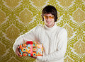 Retro hip young man glasses holding  gift box Royalty Free Stock Photography