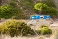 Retro hippie camper at Zavial beach in Portugal