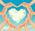 Retro Holiday background with hands making a heart and cloud. Royalty Free Stock Photo