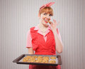 Retro housewife holding cookie tray full chocolate cookie Stock Photos