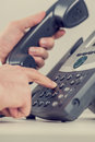 Retro image of a businessman dialing a phone number Royalty Free Stock Photo