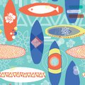 Retro inspired surfboards seamless repeat pattern. Orange, white, blue surfboards on a light blue background. Great for fabric ,