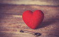 Retro key and heart shape photo in old color image style Royalty Free Stock Photo