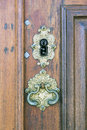 Retro keyhole an old medieval on a gold brass door with a rutsy ornate plate Royalty Free Stock Image