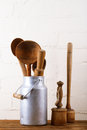 Retro kitchen utensils tools on old wooden table in rustic style and bricks wall Royalty Free Stock Photography