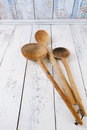 Retro kitchen utensils wood spoon on old wooden table in rustic spoons style Royalty Free Stock Image