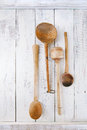 Retro kitchen utensils wood spoon on old wooden table in rustic style Stock Image