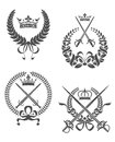 Retro laurel wreathes with swords sabers and crowns for heraldry design Stock Image