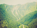 Retro look aosta valley mountains vintage looking view of aoste Stock Photography