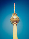 Retro look berlin fernsehturm vintage looking television tower over blue sky Stock Image