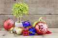 Retro look Christmas decorations with red ball,green ball,red ribbon,bell,samll tree on white pot, and artificial flower. aged and Royalty Free Stock Photo