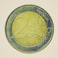 Retro look euros picture vintage looking two euro coin isolated over white background Stock Image