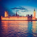 Retro look houses of parliament vintage looking westminster palace london gothic architecture at night Stock Photography