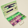Retro look money suitcase vintage looking in a seen at x ray airport check Stock Photo