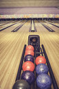 Retro look red, blue and purple bowling ball Royalty Free Stock Photo