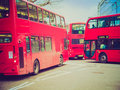 Retro look red bus in london vintage looking double decker buses a busy street notting hill uk Stock Images