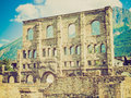 Retro look roman theatre aosta vintage looking ruins of the in aoste italy Stock Photography