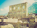 Retro look roman theatre aosta vintage looking ruins of the in aoste italy Royalty Free Stock Images
