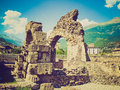 Retro look roman theatre aosta vintage looking ruins of the in aoste italy Royalty Free Stock Image