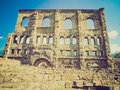 Retro look roman theatre aosta vintage looking ruins of the in aoste italy Royalty Free Stock Photography