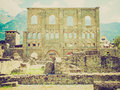 Retro look roman theatre aosta vintage looking ruins of the in aoste italy Stock Photos