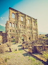 Retro look roman theatre aosta vintage looking ruins of the in aoste italy Royalty Free Stock Photos