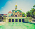 Retro look russian chapel in darmstadt vintage looking and fountain at kuenstler kolonie artists colony germany Royalty Free Stock Image
