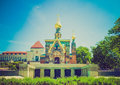 Retro look russian chapel in darmstadt vintage looking and fountain at kuenstler kolonie artists colony germany Royalty Free Stock Photo
