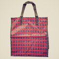 Retro look shopper bag vintage looking scottish tartan isolated over white background Royalty Free Stock Image