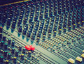 Retro look soundboard vintage looking detail of a mixer electronic device Royalty Free Stock Photos