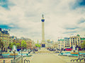 Retro look trafalgar square london vintage looking view of in from the national gallery porch with unrecognisable crowd Royalty Free Stock Image