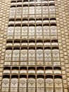 Tiling That Looks Like Library Books Stacked with Fleur De Lis Design