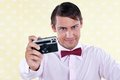 Retro male with camera holding in hand shallow depth of field focus on Royalty Free Stock Photo