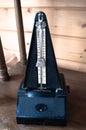 Retro metronome on vintage wooden background Royalty Free Stock Photo