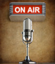 Retro microphone in the old studio with on air sign Royalty Free Stock Photo
