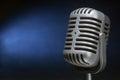 Retro microphone with spotlight Royalty Free Stock Photo