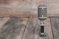 Retro microphone. Vintage style on the wooden floor background Royalty Free Stock Photo